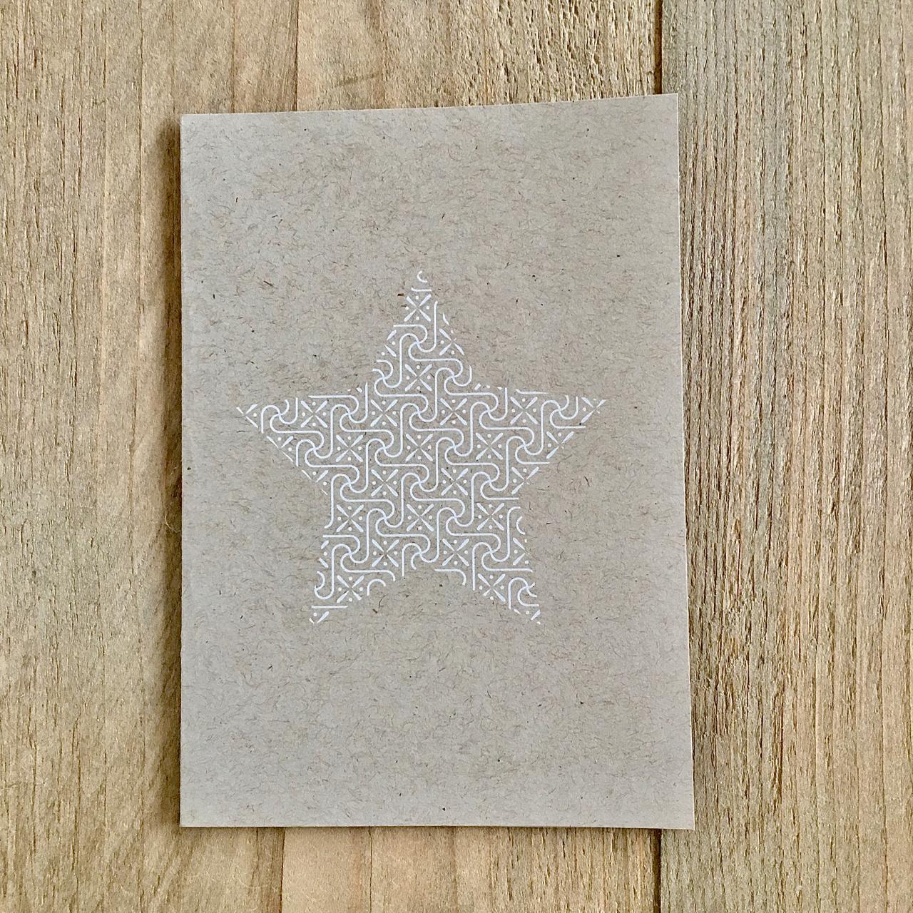 Stern in Weiß auf der Weihnachtskarte
